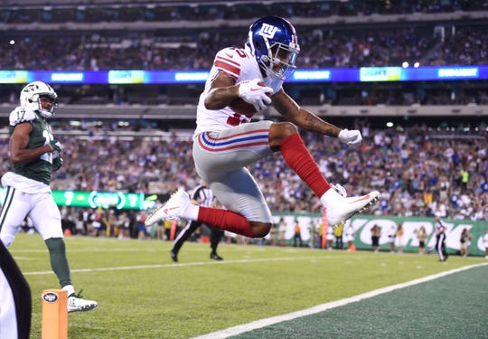 Giants vs. Jets preseason game at MetLife Stadium in East Rutherford on Friday, August 24, 2018. Giants Hunter Sharp (15) scores a touchdown in the first quarter.