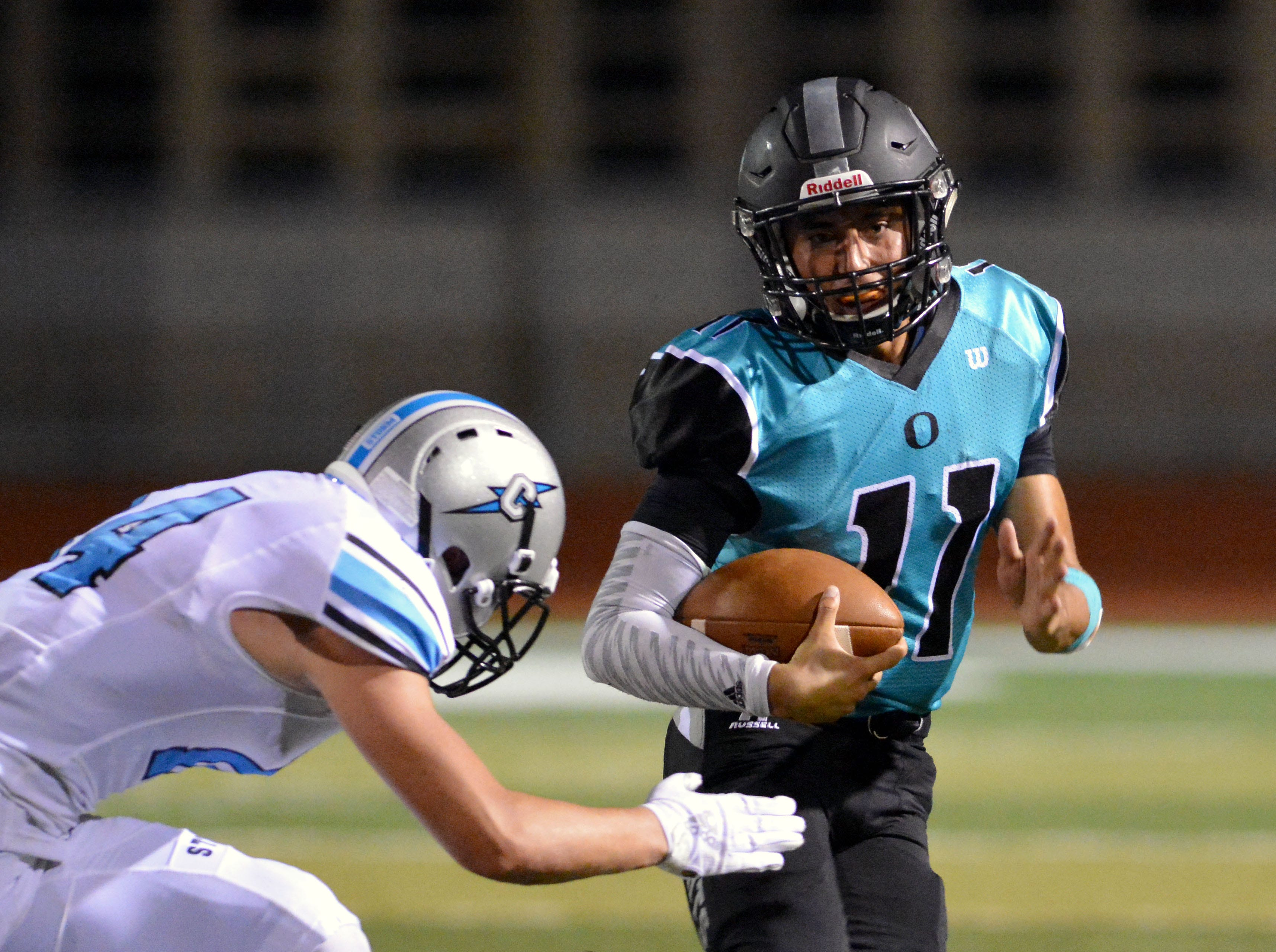 Oñate wide receiver Jayden Diaz runs for extra yards after catching a pass on Friday night against Cleveland at the Field of Dreams.