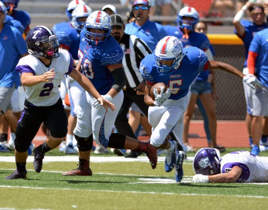 Las Cruces High's Johnny Terrazas breaks away for a long gain on Saturday afternoon against Manzano High School.