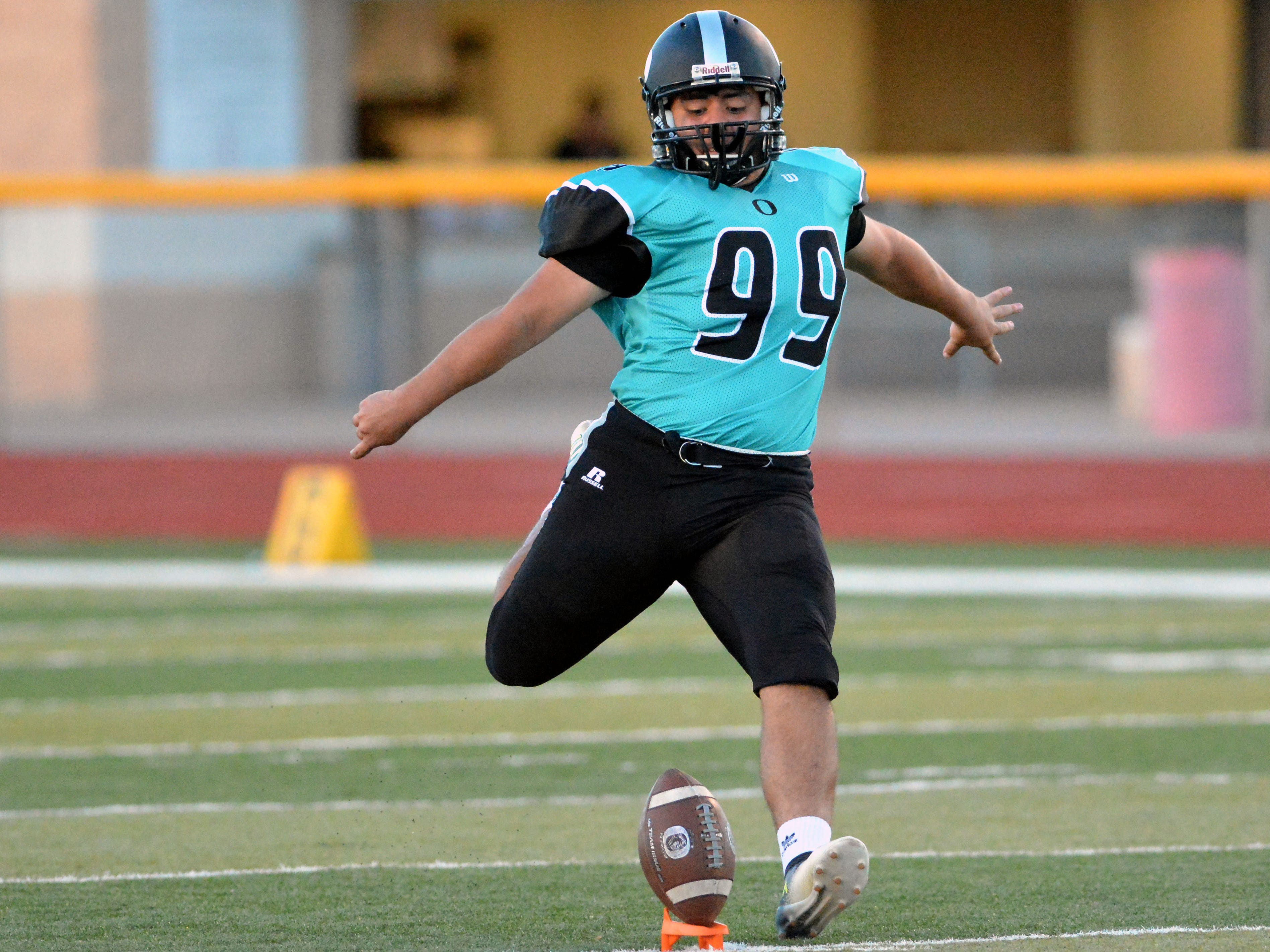 Oñate's Julian Atilano kicks off to begin the game against Cleveland High on Friday night.