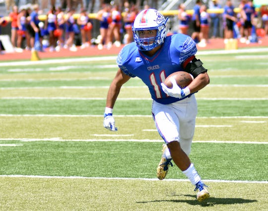 Las Cruces High's Ivan Molina has a clear path for a long gain on Saturday afternoon against Manzano High at the Field of Dreams.