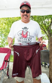 Anselmo Ensinais, of Las Cruces, shows off his new Aggie underwear that he got for his birthday on Saturday, August 25, 2018, during the tailgating prior to the New Mexico State University/University of Wyoming game at Aggie Memorial Stadium. Ensinais said he wears his lucky underwear to every football game.