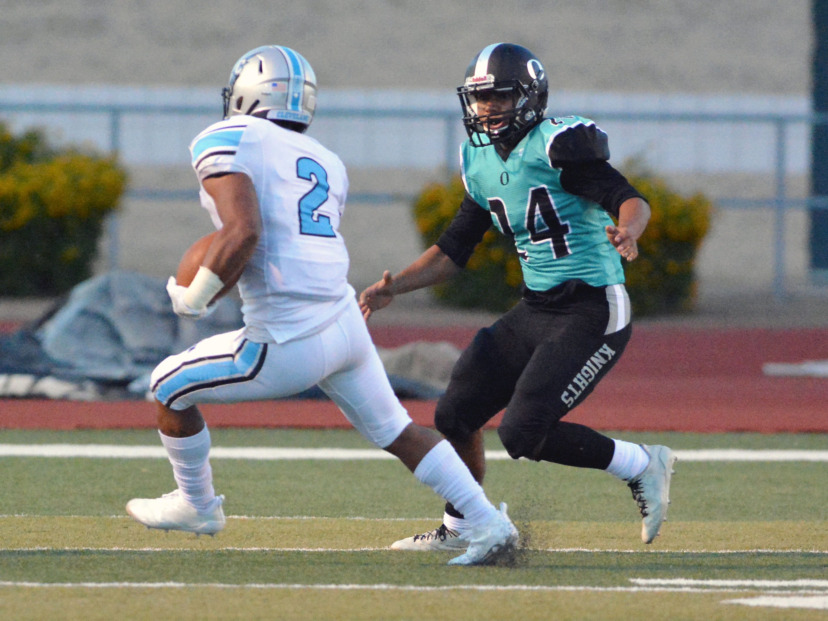 Oñate's Nasiem Al-Abayad zeros in on Cleveland running back Dorian Lewis on Friday night at the Field of Dreams.