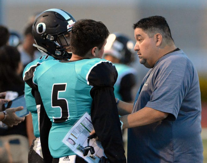 Scott Veliz, right, resigned as Oñate's head football coach on Thursday morning.