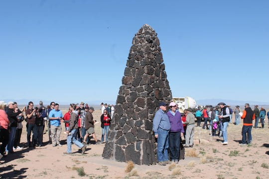 In this 2016 file photo, a couple stands in front of the Trinity Site obelisk. Trinity Site was a declared a national historic landmark in 1975.