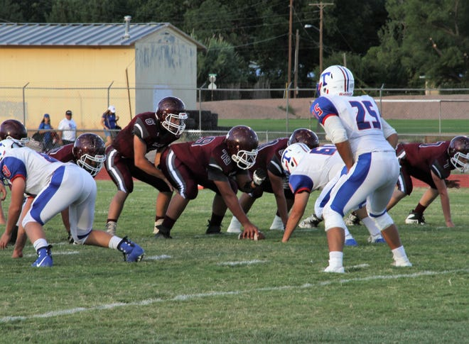 Tularosa Wildcats get ready to hike the ball during their Friday night home opening 24-22 win against the Hot Springs Tigers.