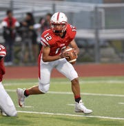 Canton quarterback Ben Stasiak rolls out of the pocket in Friday's 35-21 loss to Churchill.