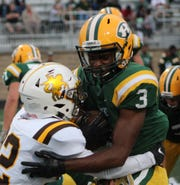 Harrison tailback Roderick Heard (3) is stopped at the line by North Farmington defender Justin Bryant.