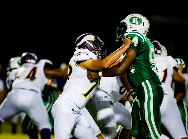 OC offensive tackle Alex Castille battles with a Eunice defender in the jamboree game Friday in Eunice.