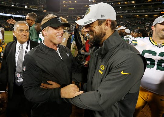 Raiders coach Jon Gruden, left, greets Packers quarterback Aaron Rodgers after an NFL preseason game on Aug. 24, 2018.