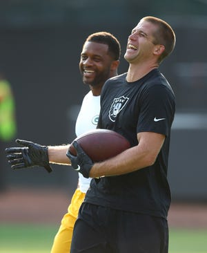 Oakland Raiders wide receiver Jordy Nelson, right, laughs with Green Bay Packers wide receiver Randall Cobb before an NFL preseason football game between the Raiders and the Packers in Oakland, Calif., Friday, Aug. 24, 2018.