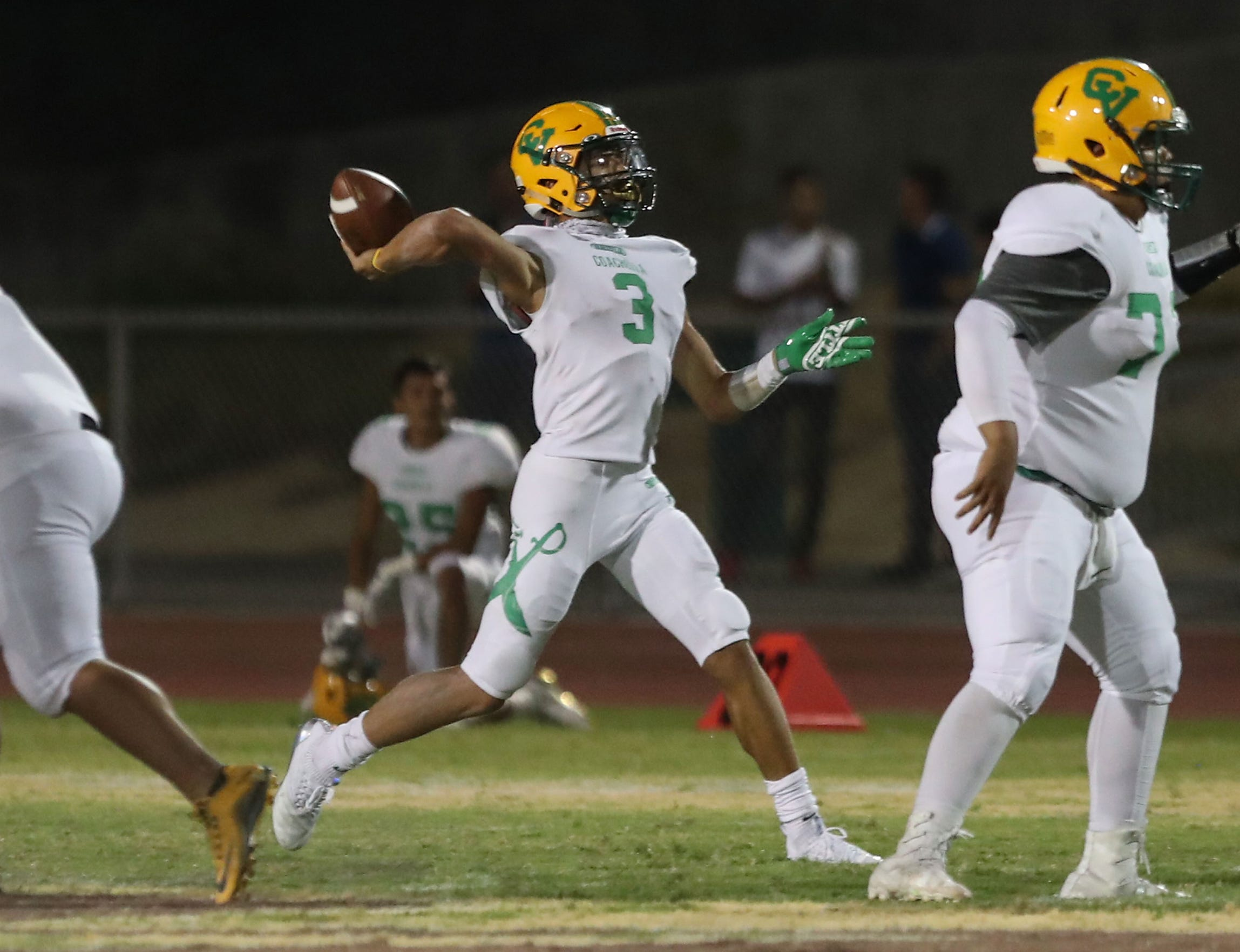 Coachella Valley quarterback Donny Fitzgerald throws a touchdown pass against Rancho Mirage, August 24, 2018