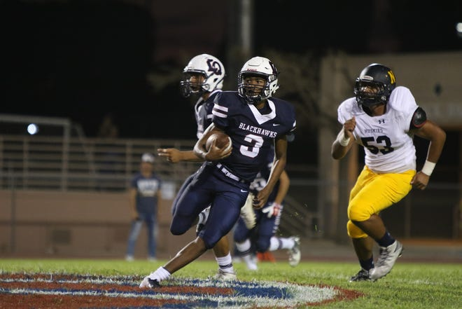 08/24/18 Taya Gray, Special to The Desert SunLa Quinta's quarterback Christian Egson runs the ball during the first half of the game against JW North in La Quinta on Friday, August 24, 2018.