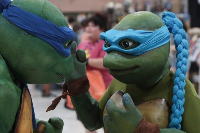 A pair of teenage mutant ninja turtles talk at Comic Con Palm Springs, Saturday, August 25, 2018.