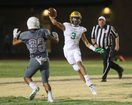Coachella Valley quarterback Donny Fitzgerald throws a pass against Rancho Mirage, August 24, 2018