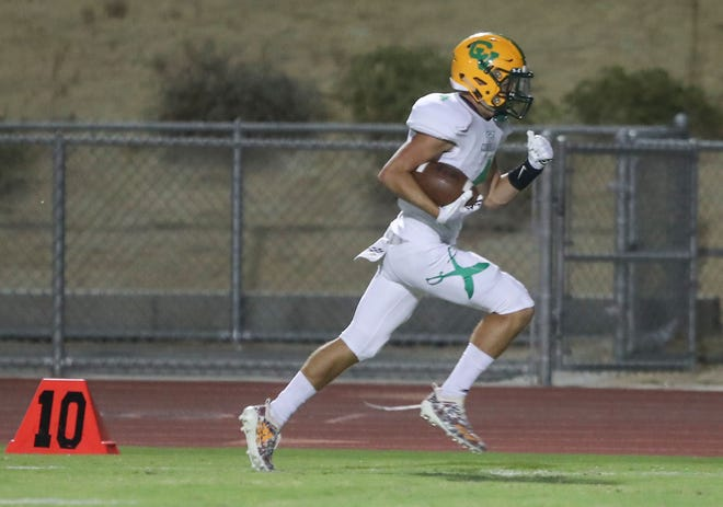 Coachella Valley's Angelo Fitzgerald scores a touchdown against Rancho Mirage, August 24, 2018