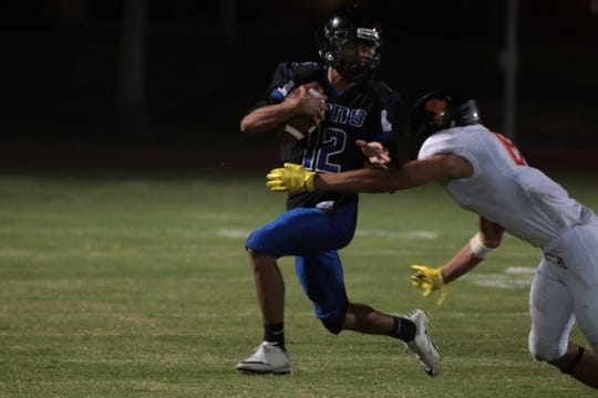 Nico Guardiola carries the ball for Cathedral City at Cathedral City High School, Friday, August 24, 2018.