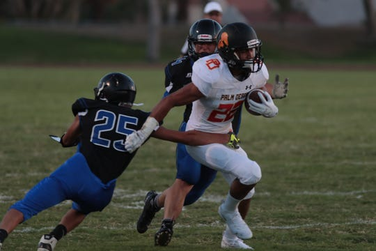 Jordan Garcia carries the ball for Palm Desert at Cathedral City High School, Friday, August 24, 2018.