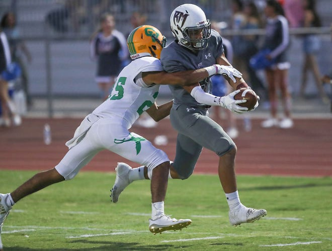 Kevin Dorsey catches a touchdown pass for Rancho Mirage and their first touchdown against Coachella Valley, August 24, 2018