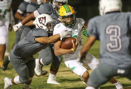 Coachella Valley quarterback Donny Fitzgerald runs against Rancho Mirage, August 24, 2018