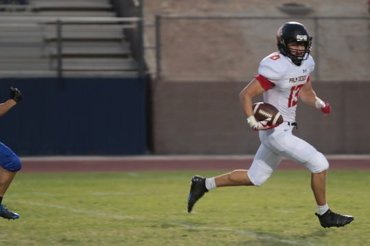Devin Lopez runs for a Palm Desert touchdown at Cathedral City High School, Friday, August 24, 2018.