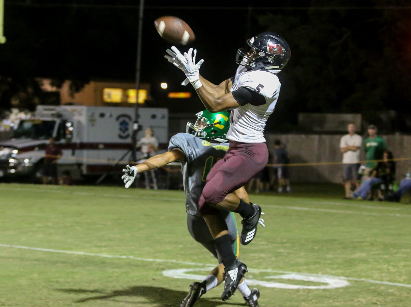 Navarre's Dante Wright (5) turns around at the right moment to catch a throw from quarterback Garon Finley and then runs it into the end zone for a touchdown at Catholic High School on Friday, August 24, 2018.