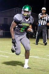 Pensacola Catholic's Ja'kobi Jackson (5) returns a Navarre kickoff at Catholic High School on Friday, August 24, 2018.