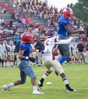 A pass gets past defender Martin Emerson (1) and intended receiver Ernest Stallworth (5) during the PHS vs Pine Forest football game at Pine Forest High School in Pensacola on Friday, August 24, 2018.