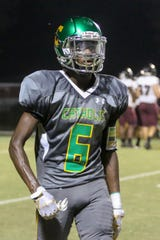Pensacola Catholic's Demarius McGhee (6) looks to the sideline for the next call against the Navarre Raiders at Catholic High School on Friday, August 24, 2018.