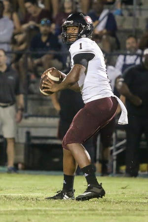 Navarre quarterback Marlon Courtney (1) throws a pass against the Crusaders at Catholic High School on Friday, August 24, 2018.