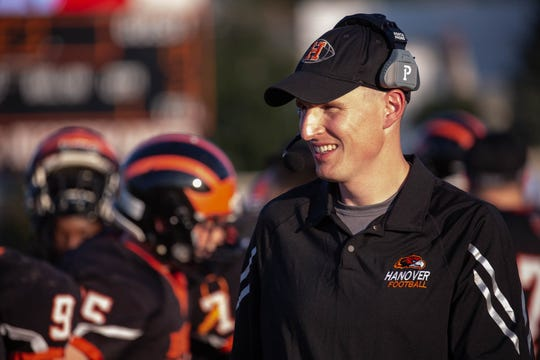 In this file photo, Hanover head coach Brandon Bishop smiles before a football game between Hanover and Susquehannock, Friday, Aug. 24, 2018, at the Sheppard-Meyers field in Hanover.