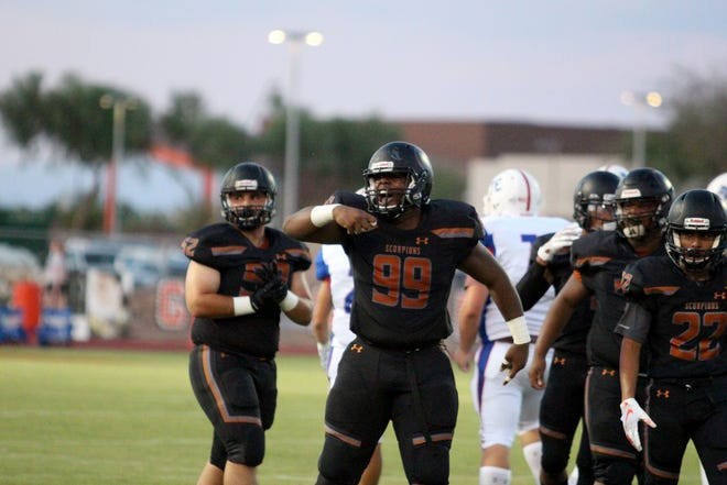Desert Edge's Nassir Sims celebrates after his first sack of the game against Moon Valley, Goodyear, Ariz. August 24, 2018.