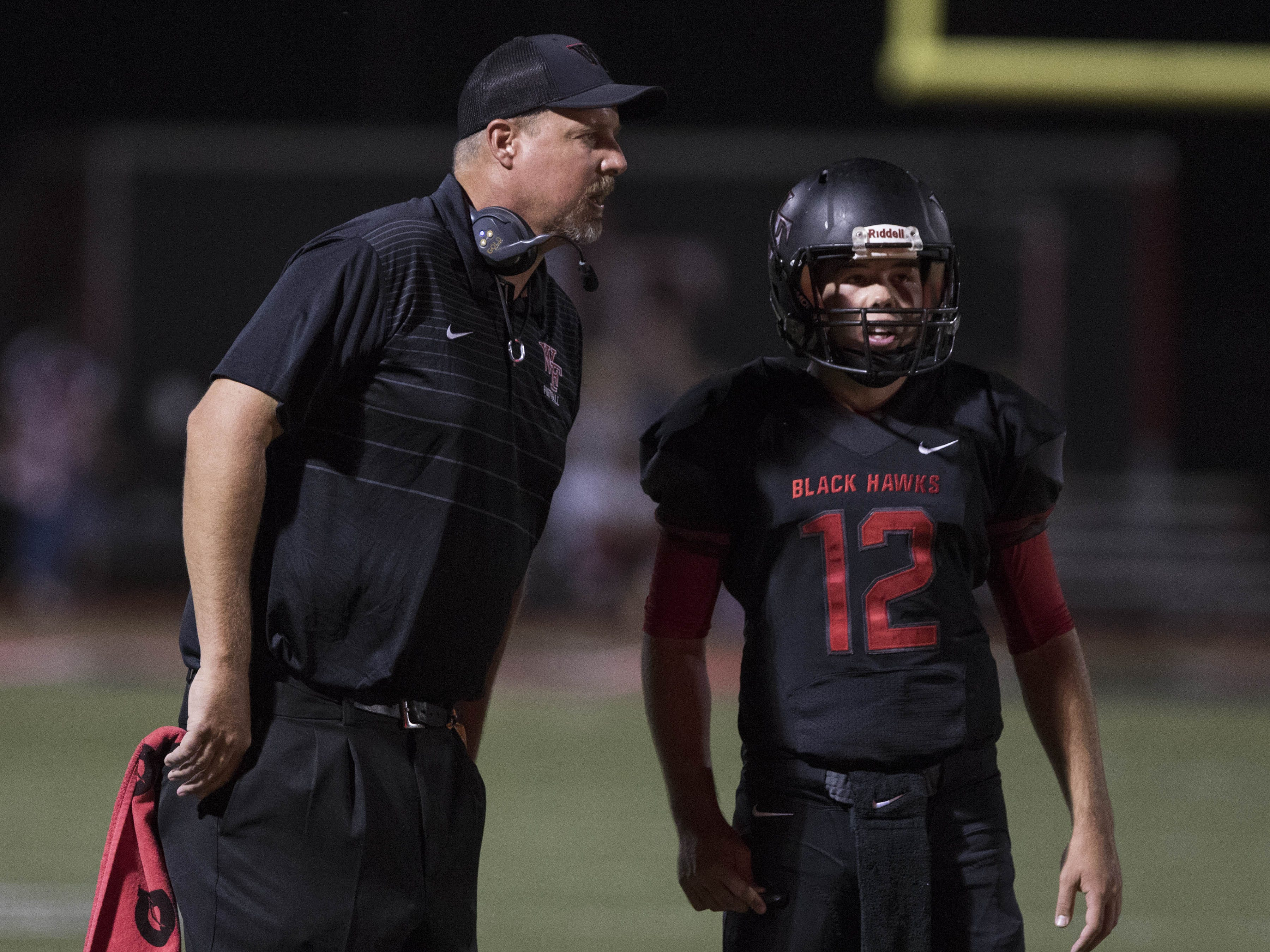 Williams Field head coach Steve Campbell talks to his quarterback Zack Shepherd during their game with Sunrise Mountain in Gilbert Friday, Aug.24, 2018.#azhsfb