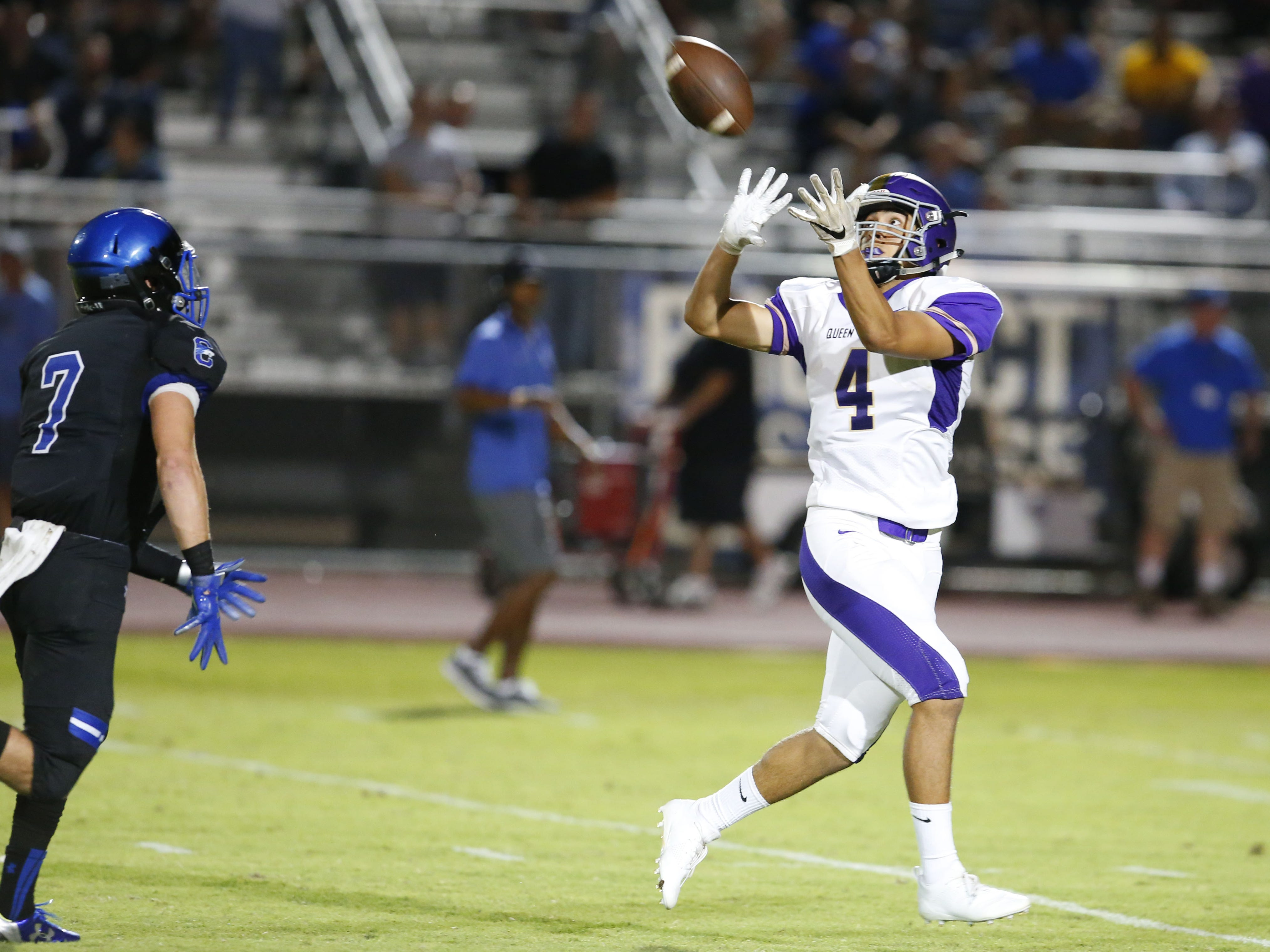 Queen Creek Alec Prochazka (4) completes the catch for a touchdown during a high school football game against Chandler at Chandler High on August 24, 2018. #azhsfb