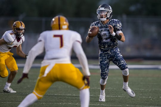 Pinnacle's Spencer Rattler looks to throw against Mountain Pointe during the 1st quarter on Friday, Aug. 24, 2018, at Pinnacle High School in Phoenix.   #azhsfb