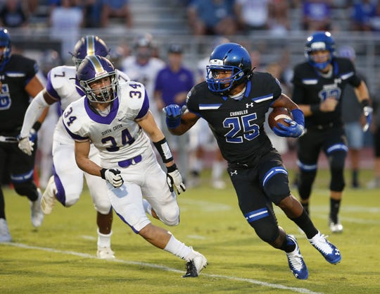 Queen Creek Zane Lalama (34) attempts to tackle Chandler Decarlos Brooks (25) during a high school football game at Chandler High on August 24, 2018. #azhsfb