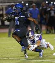 Chandler Jaheim Brown-Taylor (8) breaks free from Queen Creek Danny Marshall (21) during a high school football at Chandler High on August 24, 2018. #azhsfb