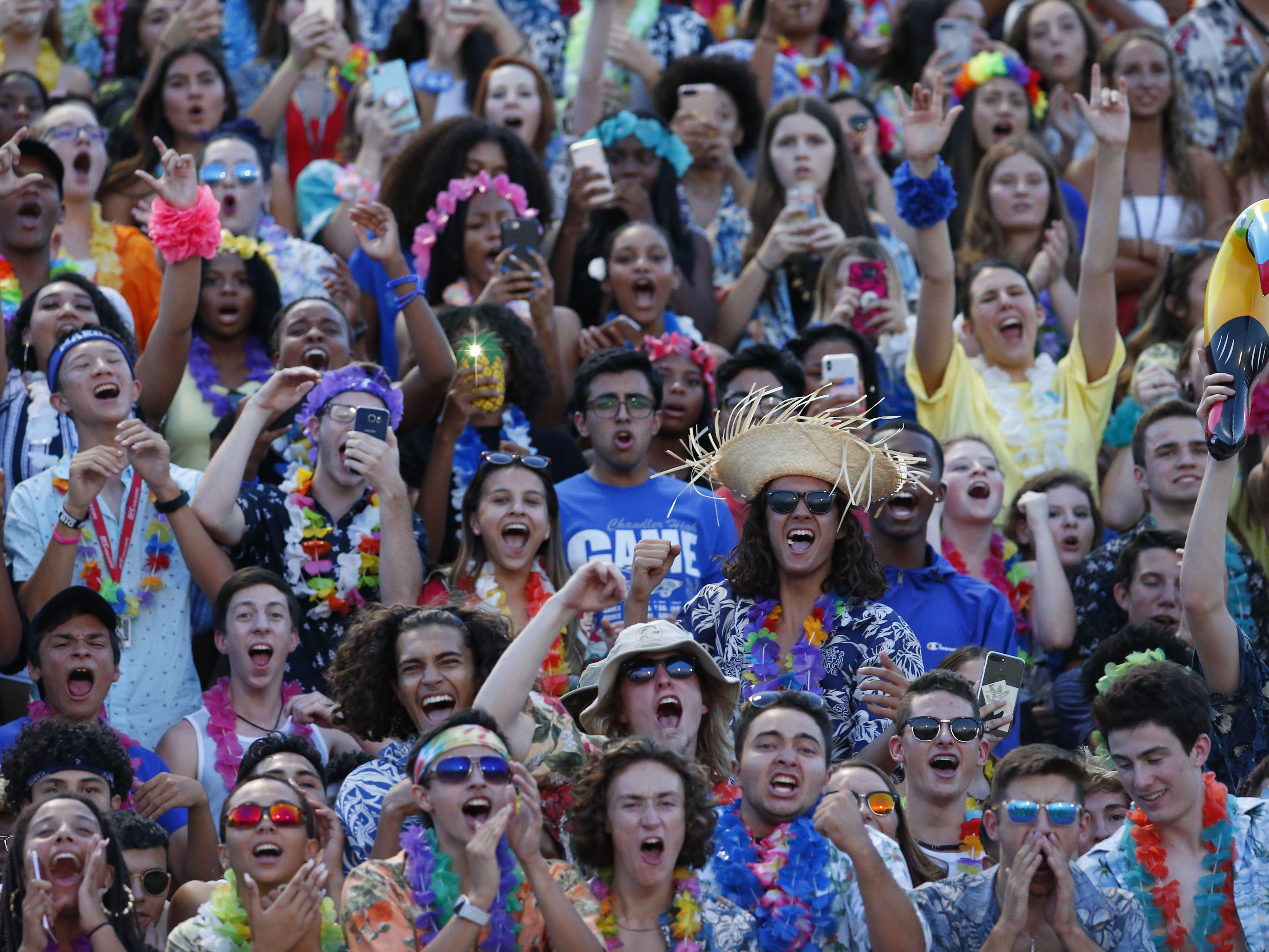 Chandler fans cheer during a high school football game against Queen Creek at Chandler High on August 24, 2018. #azhsfb