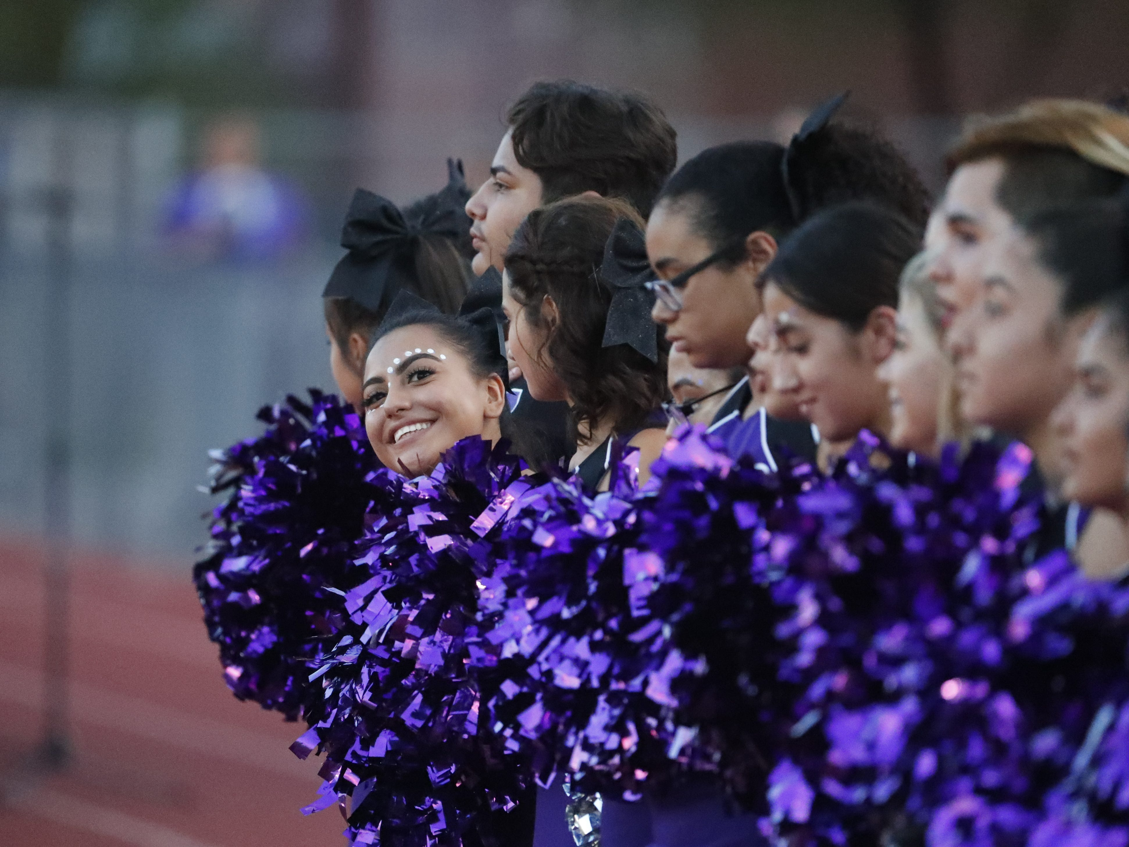 Cesar Chavez cheerleaders joke around before a game against Red Mountain at Cesar Chavez High School in Phoenix, Ariz. on Aug. 23, 2018.