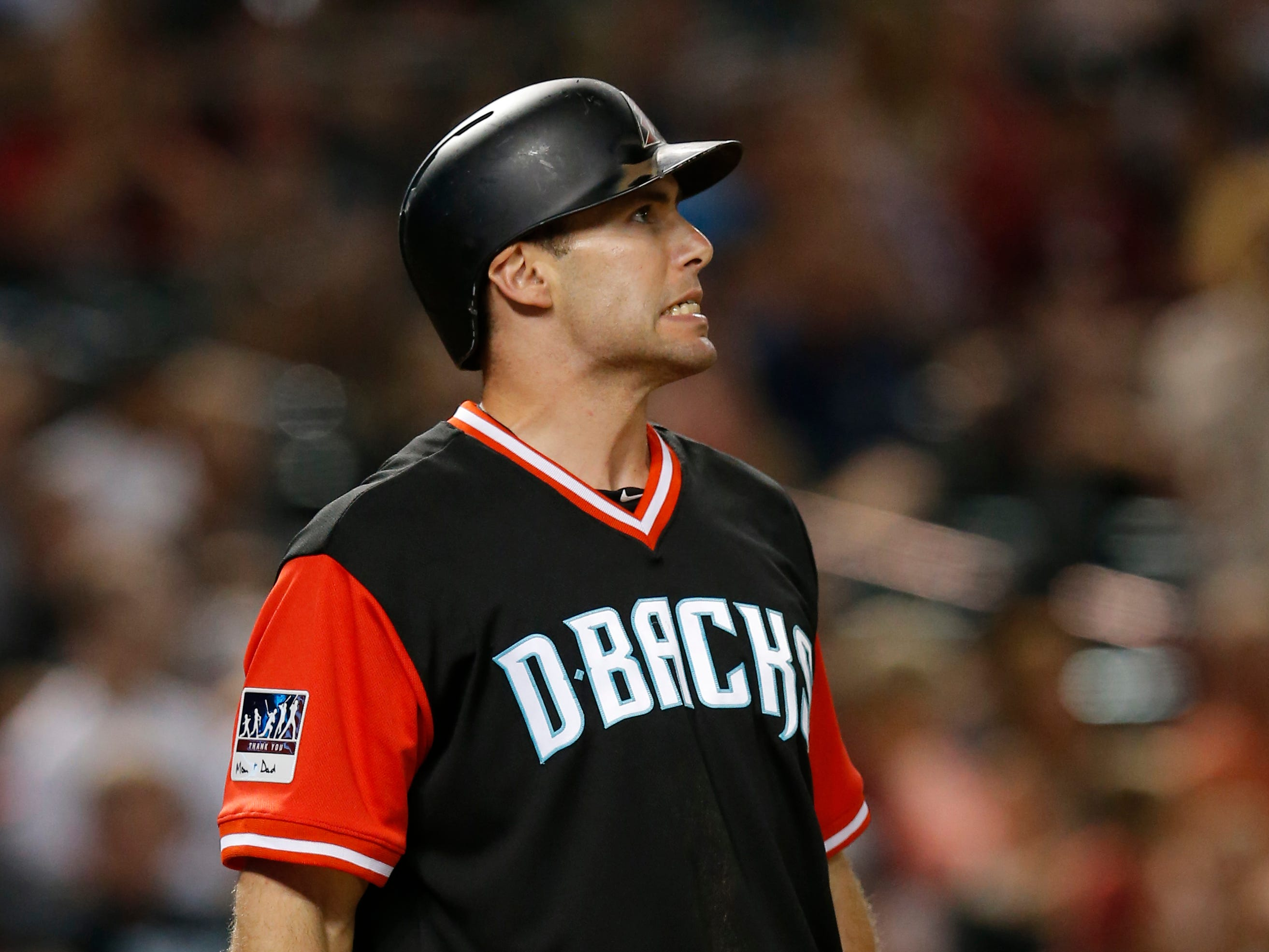 Arizona Diamondbacks' Paul Goldschmidt reacts after striking out in the eighth inning of the team's baseball game against the Seattle Mariners, Friday, Aug. 24, 2018, in Phoenix.