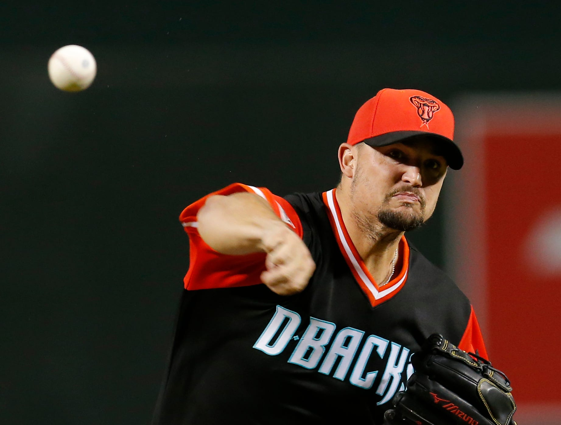 Arizona Diamondbacks pitcher Zack Godley throws during the first inning of the team's baseball game against the Seattle Mariners, Friday, Aug. 24, 2018, in Phoenix.
