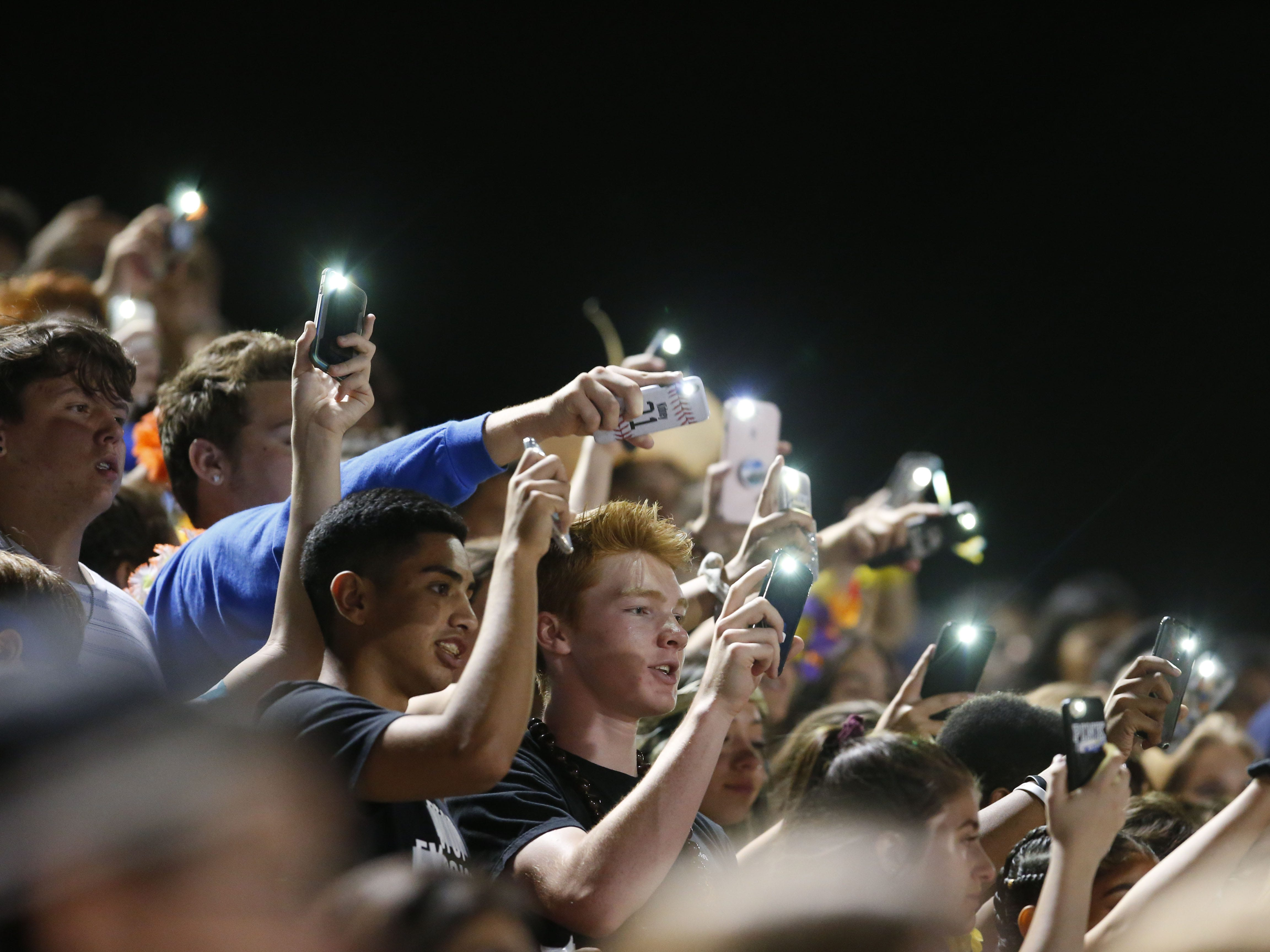Chandler fans cheer after a touchdown during a high school football against Queen Creek at Chandler High on August 24, 2018. #azhsfb