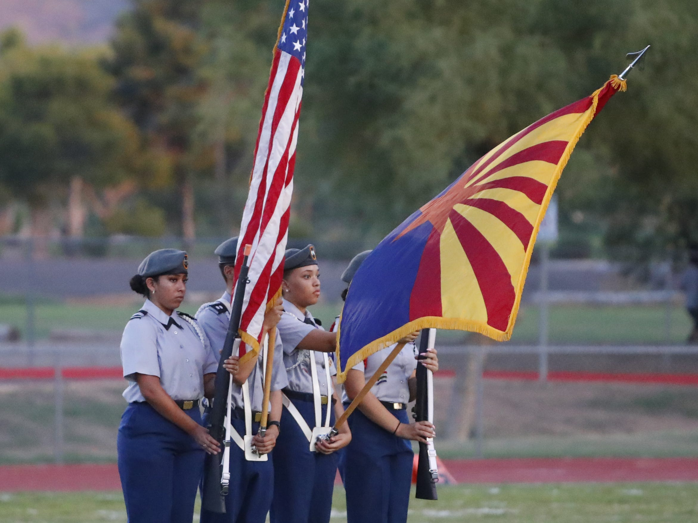 Cesar Chavez's color guard holds the flags during a game at Cesar Chavez High School in Phoenix, Ariz. on Aug. 23, 2018.