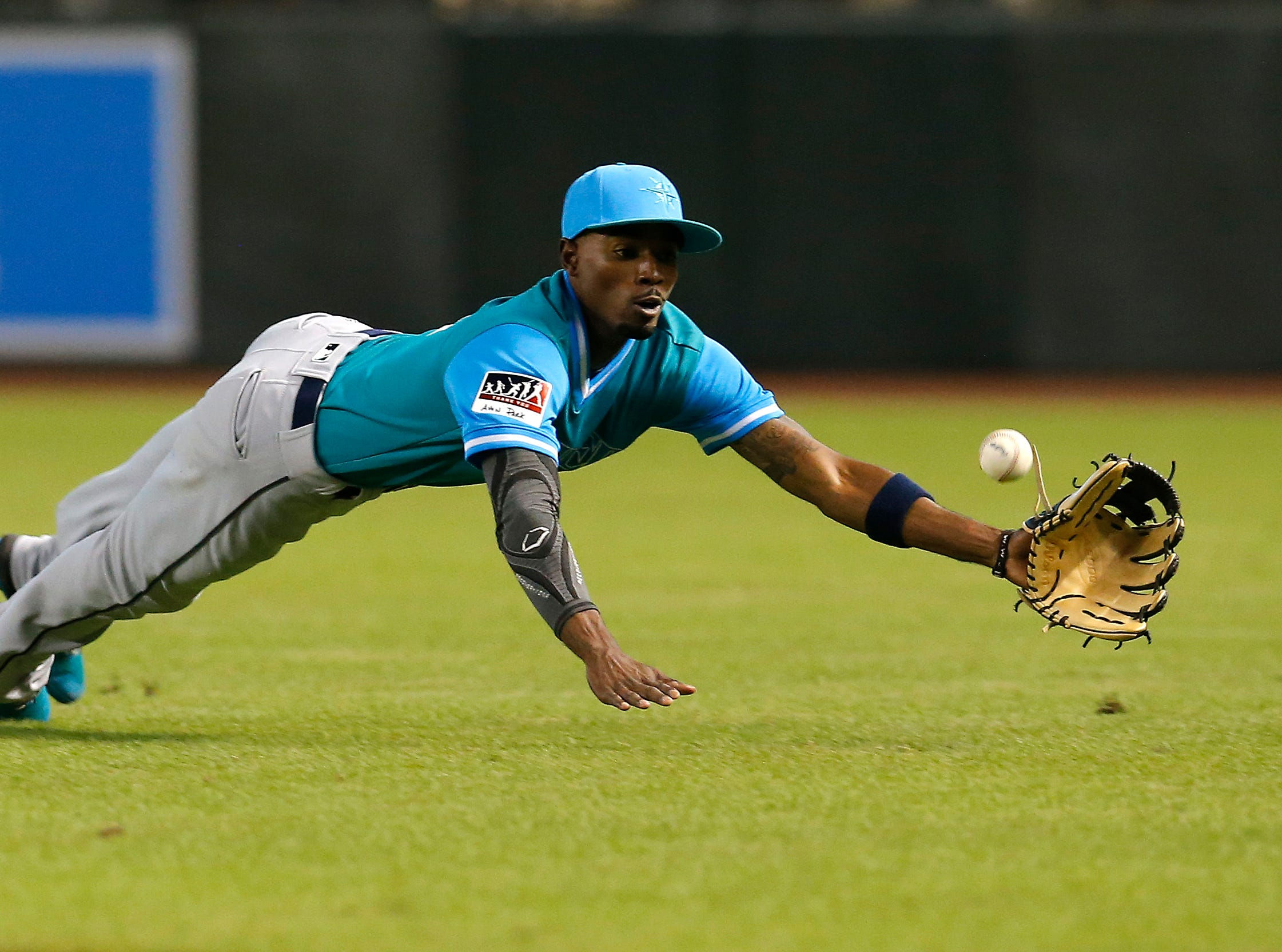 Seattle Mariners second baseman Dee Gordon makes the catch on a ball hit by Arizona Diamondbacks' Eduardo Escobar in the first inning during a baseball game Friday, Aug. 24, 2018, in Phoenix.