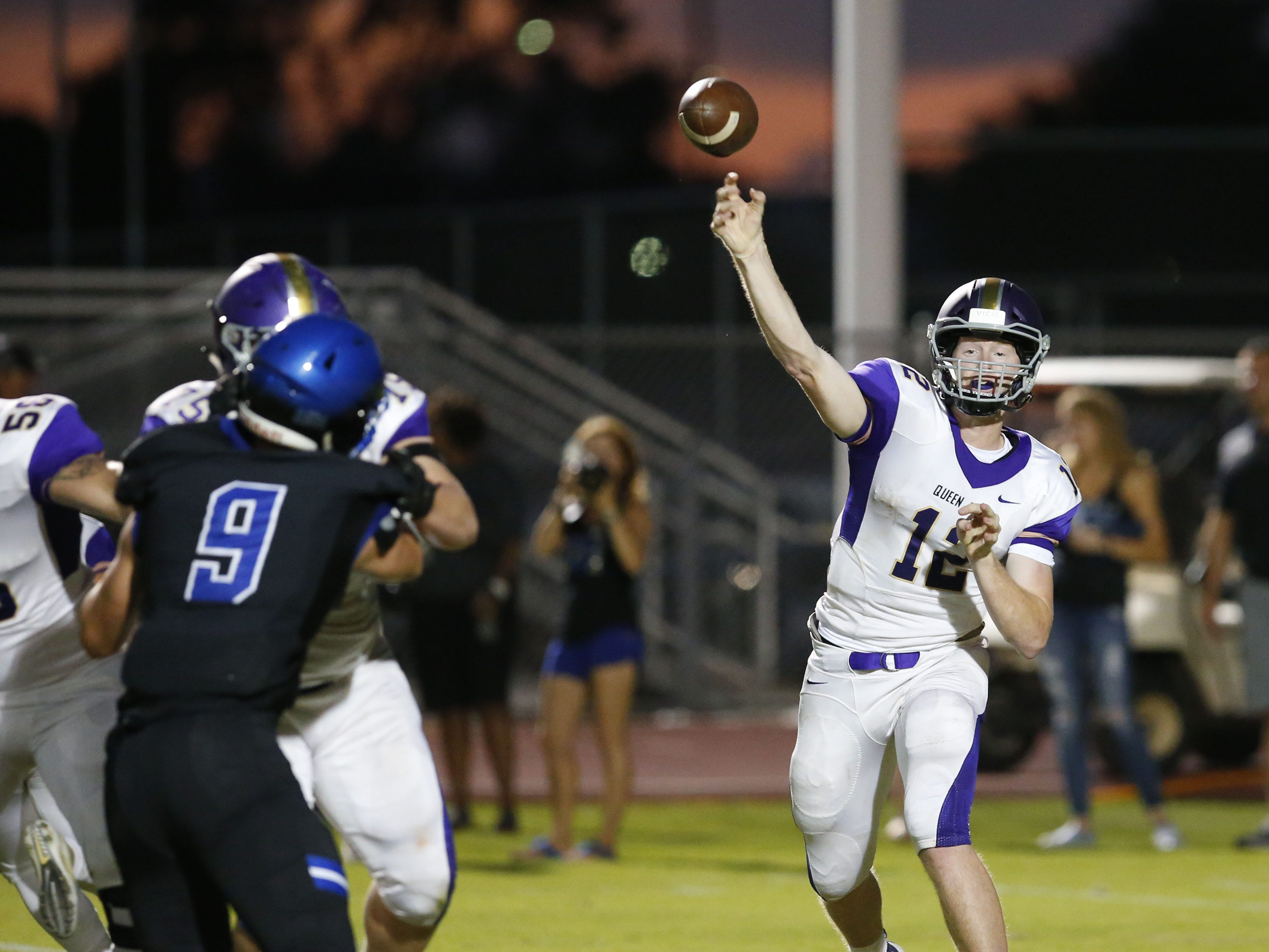 Queen Creek Devin Larsen (12) passes the ball during a high school football game against Chandler at Chandler High on August 24, 2018. #azhsfb