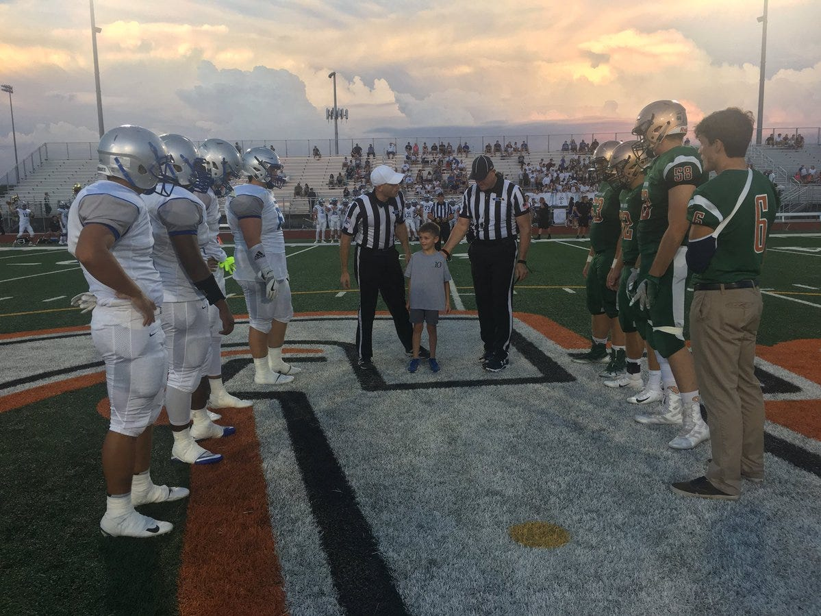 Gilbert rivals Mesquite and Campo Verde meet at midfield for the coin toss before their game on Friday, Aug. 24, 2018.