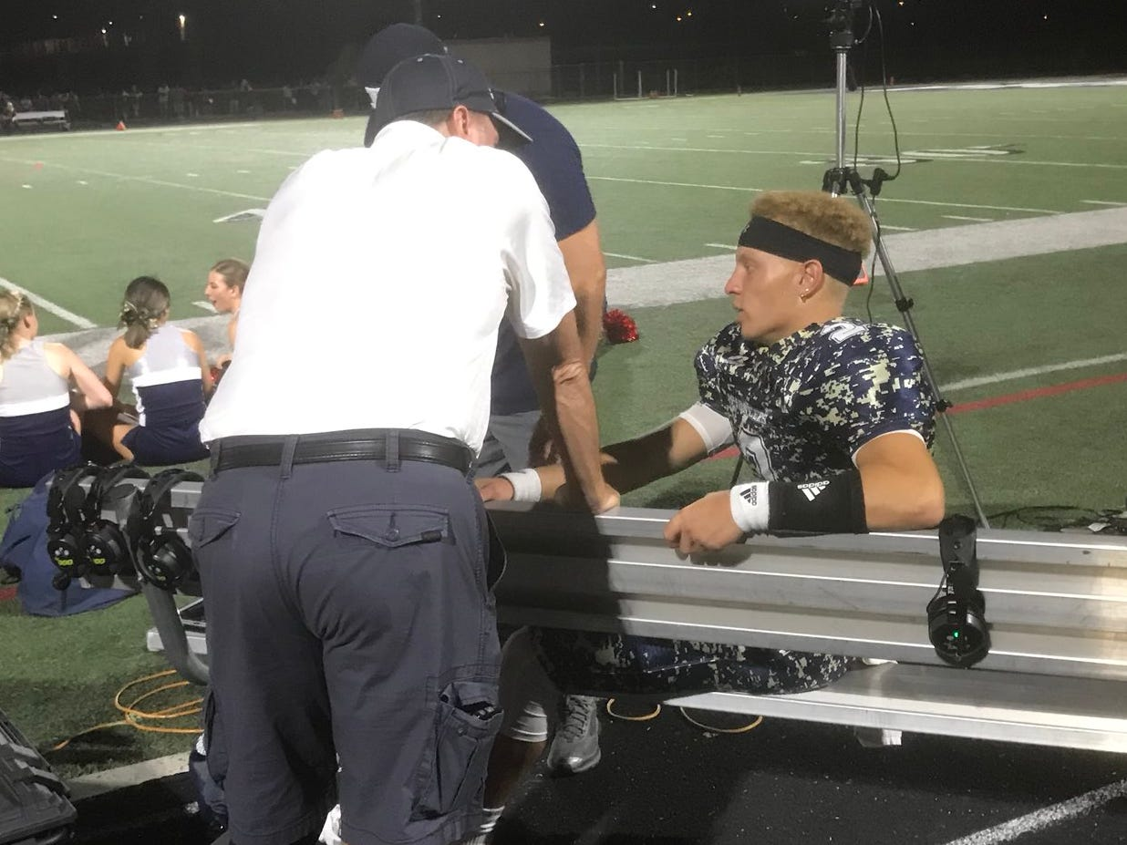 Pinnacle's Spencer Rattler being treated on the sideline