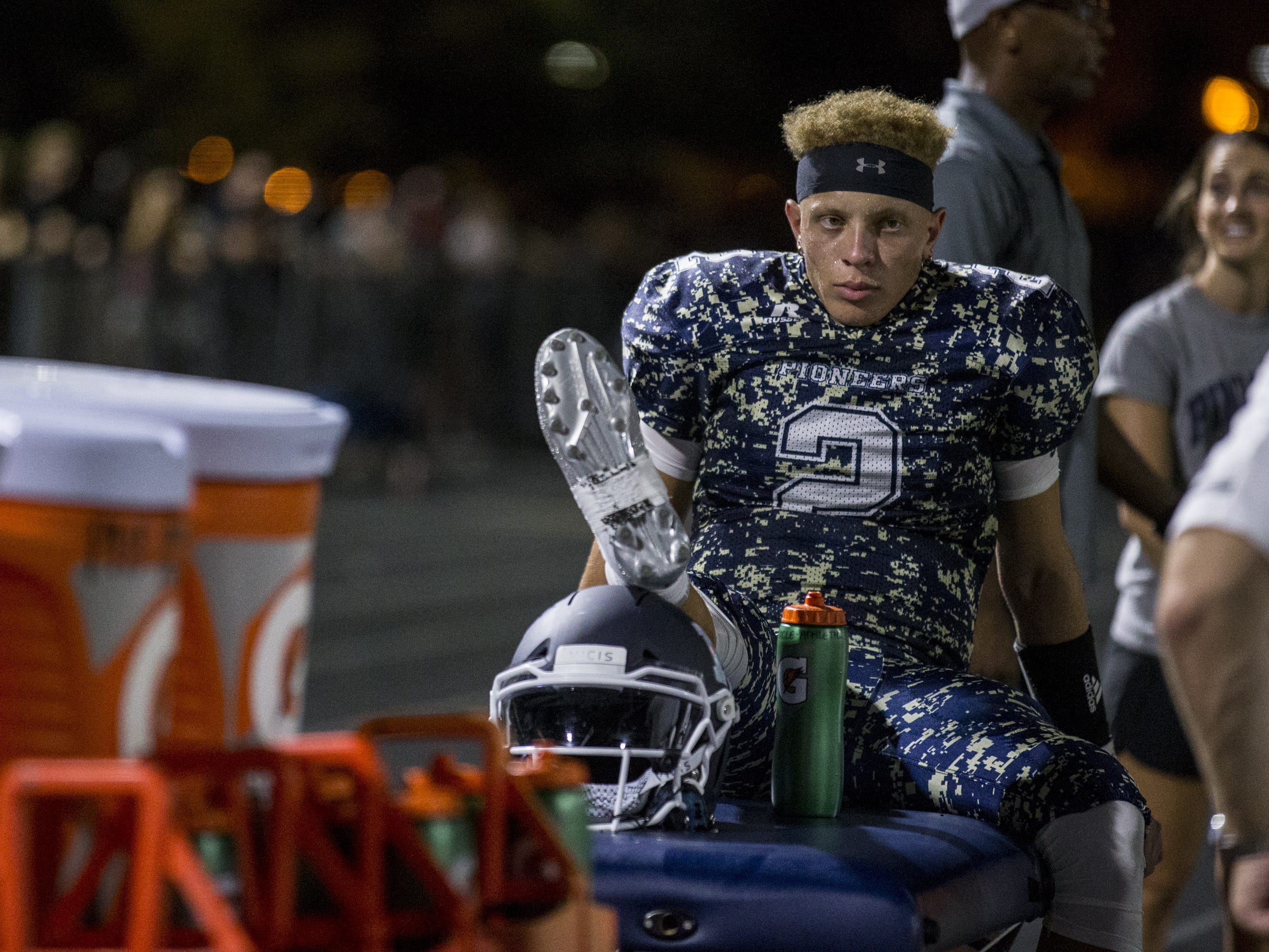 Pinnacle's Spencer Rattler sits on the sideline after being injured during the game against Mountain Pointe on Friday, Aug. 24, 2018, at Pinnacle High School in Phoenix.   #azhsfb