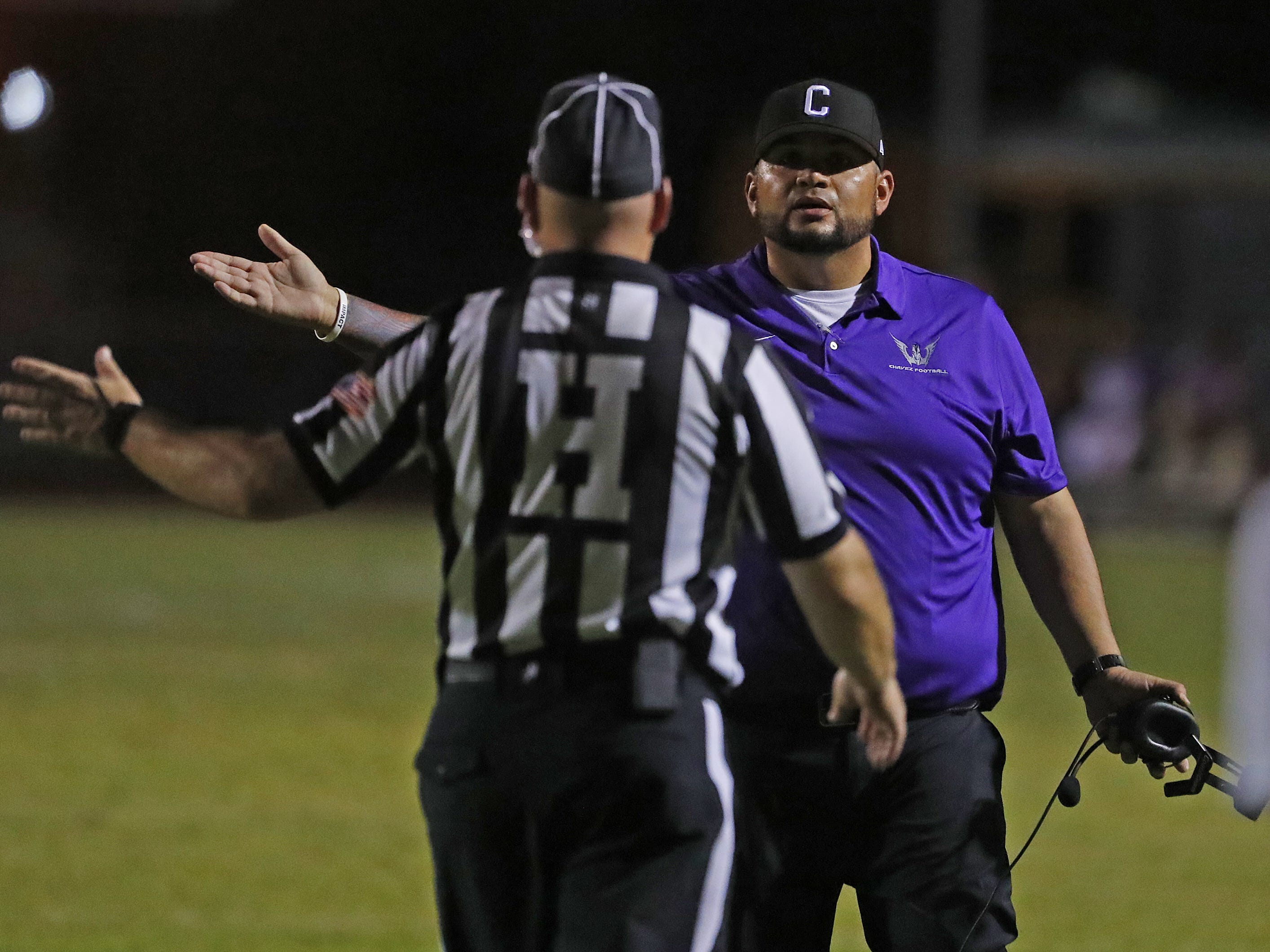 Cesar Chavez's head coach Manuel Alcantar argues with an official during a game at Cesar Chavez High School in Phoenix, Ariz. on Aug. 23, 2018.  #azhsfb