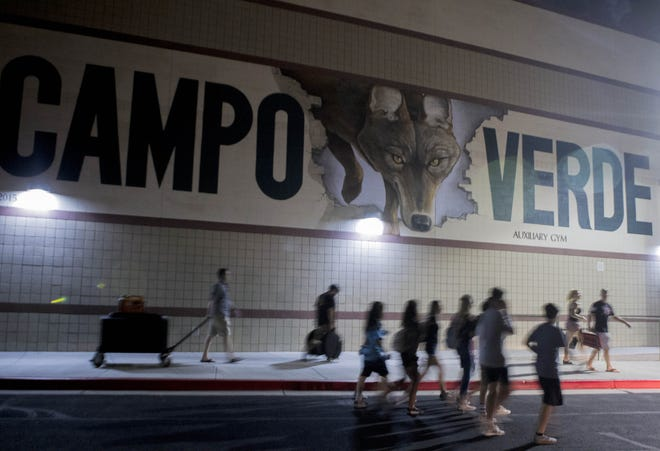 Campo Verde High School band members take their instruments inside as they seek shelter after halftime of their game with Mesquite. Weather caused a delay during their game in Gilbert Friday, Aug. 24, 2018. Campo Verde was up 22-7 at halftime. #azhsfb